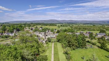 Wonderful aerial view by drone down the back garden to Temple Sowerby Hotel and the Northern Pennines beyond.