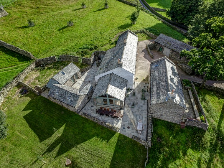 Drone photo looking down on stunning remote holiday home situated in the Lake District, Cumbria in sunshine