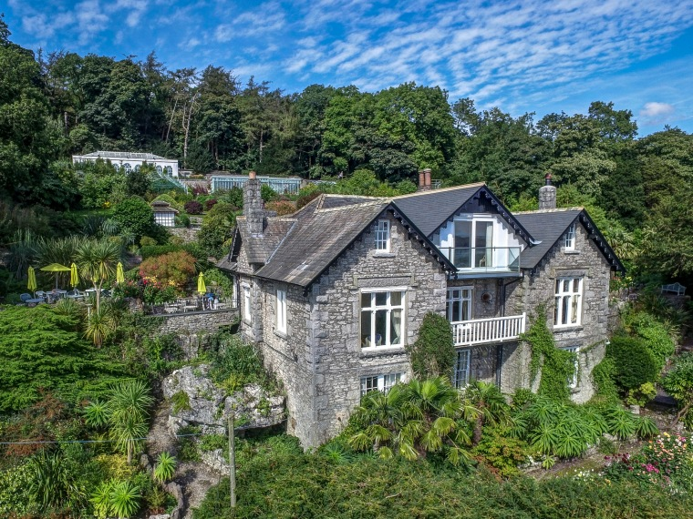 Yewbarrow House with gardens all around, photographed from hovering drone by Colin Aldred of Aerial Artwork