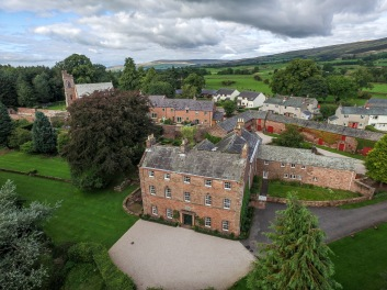 Melmerby Hall, church and village taken from the drone whilst capturing video for a publicity film for holiday homes.