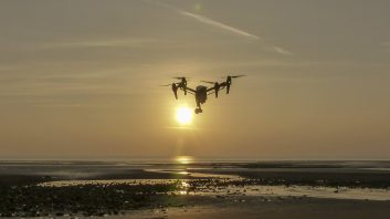 Aerial Artwork's DJI Inspire 1 in flight above a Cumbrian beach silhouetted against the setting sun