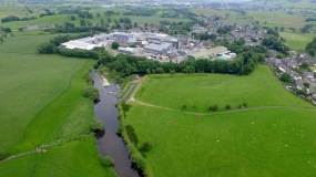 Aerial view down the River Kent to the papermaker's factory